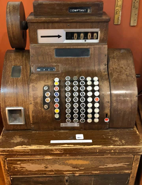 an old wooden cash register
