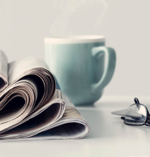 Picture of news paper and coffee mug